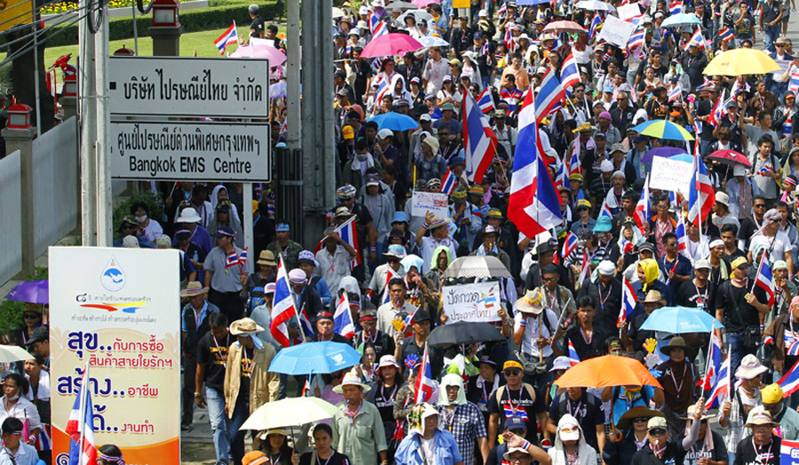 Thai protesters swarm telecommunications agencies