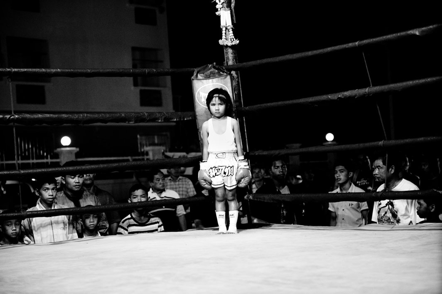 Girl, 6 years, in a boxing ring. Muay Thai (Thai Boxing) is one